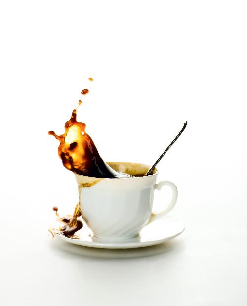 091009-coffee-splashing-from-white-coffee-cup22510_size_261610984